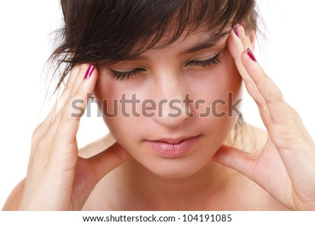 A beautiful girl is having a headache - isolated on white