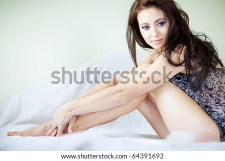 A beautiful girl resting on a bed in the morning