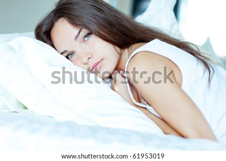 A beautiful girl resting on the bed