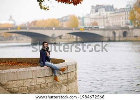 A beautiful girl walks along the Seine river in Paris Stock photo ©