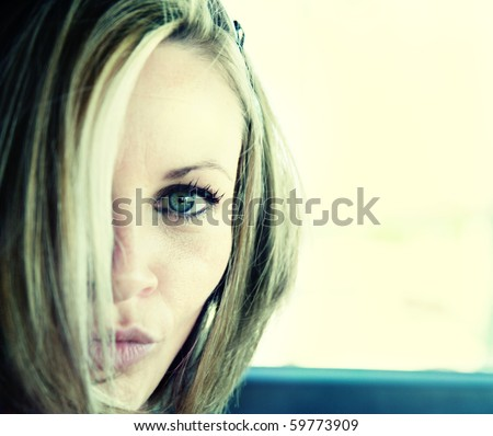 a beautiful girl with hair in face