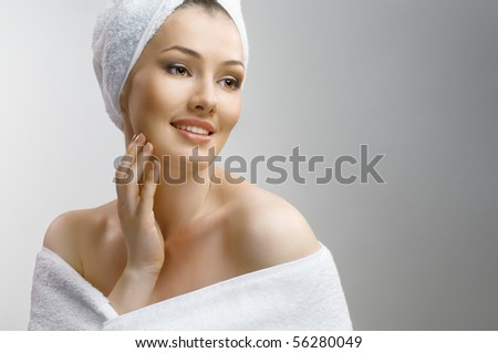 a beautiful girl wrapped in the bathtowel