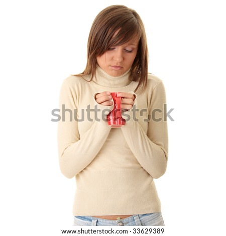 A beautiful girl (young woman) wearing polo neck sweater  holding a cup of hot drink - stock photo