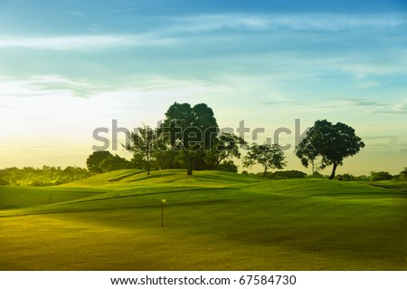A beautiful golf course in the Philippines during sunset - stock photo