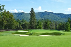 A Beautiful Golf Course with manicured Fairway and Beautiful Mountain Scenery