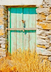A beautiful green colored wooden door of a traditional old house in Chora the capital of Amorgos island in Greece