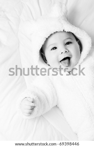 A beautiful happy baby lying on white background