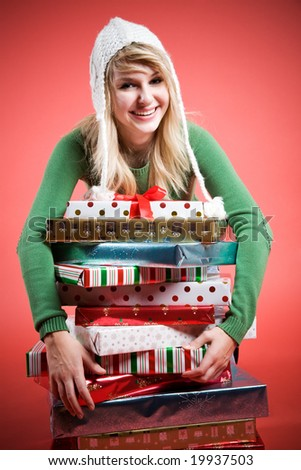 A beautiful happy caucasian girl hugging her gifts