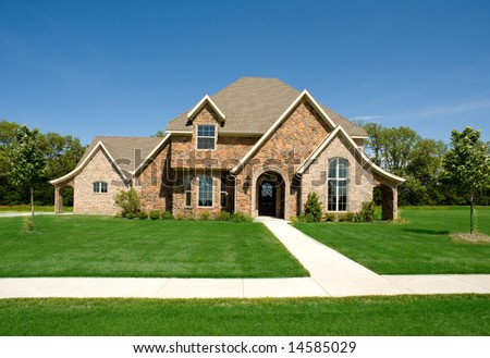 A beautiful home or house on a sunny day, construction industry, real estate or architecture concept