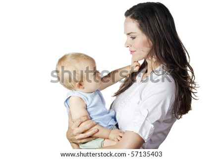 A beautiful image of a young mother and her baby looking at each other. Isolated on white.