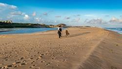 A beautiful Indian Tourist enjoying the beauty of Puri Beach.