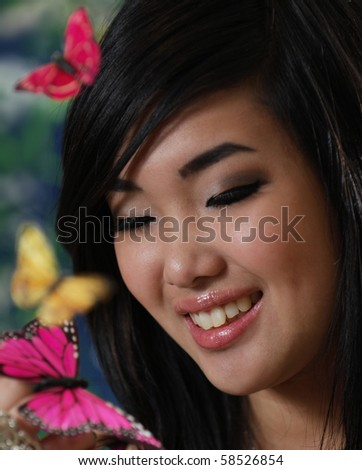 Beautiful Korean Girl With Butterflies Landing On Her Hand Stock