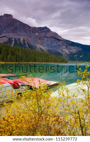 A beautiful lake surrounded by mountains in Autumn