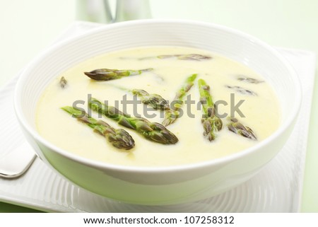 A beautiful light, creamy asparagus soup, flavoured with chicken stock, sour cream and basil. Stock photo ©