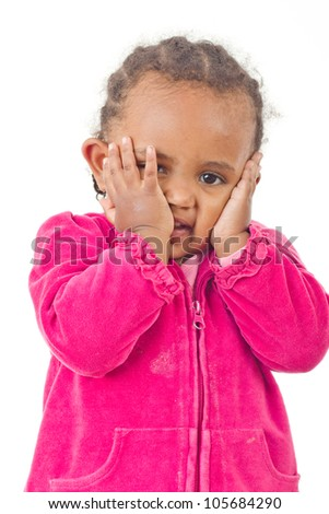 A beautiful little girl in a playful mood trying to express herself with gesture - stock photo
