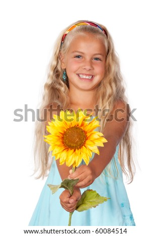a beautiful little girl smiling and holding a sunflower