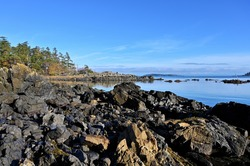A beautiful look at the rugged coastal scenery with sharp rocks dominating the coastline fully exposed during low tide