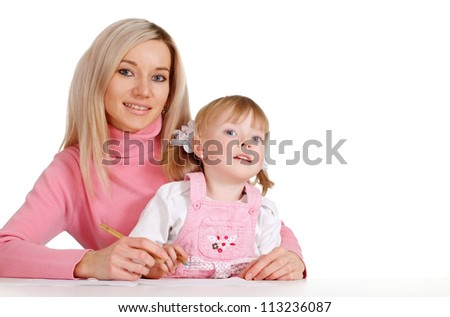 A beautiful mama with her daughter paint crayons on a white background