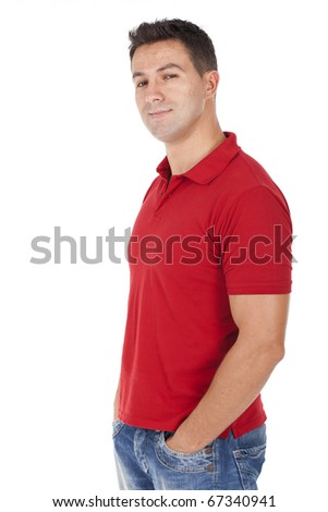 a beautiful man smiling with his hands on the pockets - stock photo