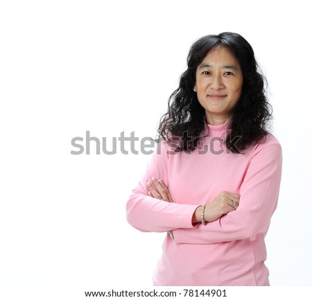 A Beautiful Mature Asian Lady Smiles Confidently