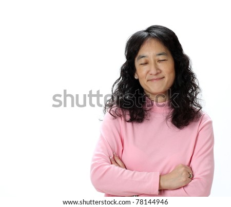 A Beautiful Mature Asian Lady Smirks While Thinking Happy Thoughts With Her Eyes Closed