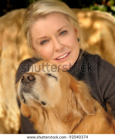 A beautiful middle aged woman In Love with Her Golden retriever
