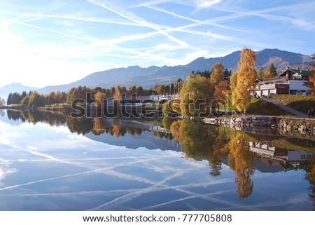 A beautiful mirror-like reflection on  Etang Long, Crans Montana, Switzerland.  Photo stock ©