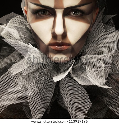 a beautiful model with milk and chocolate sectors make up and gorgeous black and white frill (jabot) in italian renaissance style. studio shot.