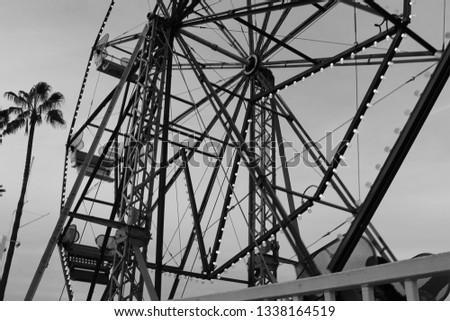 A beautiful monochromatic shot of a still Ferris wheel. #1338164519