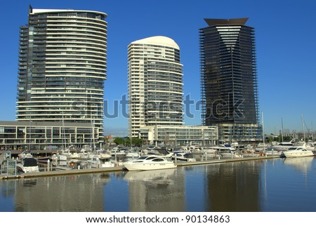 A beautiful morning at the Docklands with boats and yachts on the water in melbourne australia