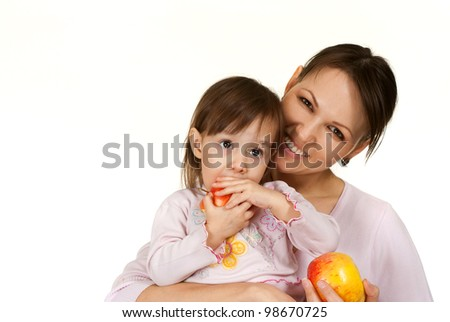 A beautiful mother with a beautiful daughter on a light background