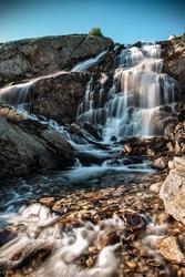 A beautiful mountain waterfall near the Grimsel Pass. Canton of Bern, Switzerland