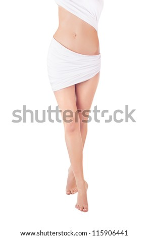 A beautiful naked woman's body covered with blue silk on a white background