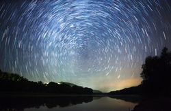 a beautiful night sky, Milky Way, star trails  and the trees