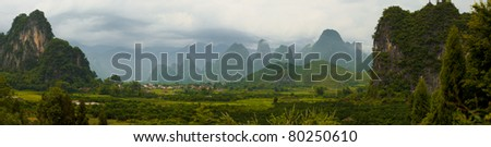 A beautiful panorama of the Xingping countryside surrounded by karst formations nearby Yangshuo, China