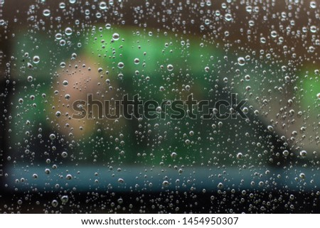 A beautiful picture of a window with raindrops on it taken during rain. Picture is perfectly sharp and quite contrasty as well. #1454950307