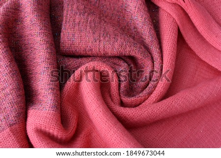 A beautiful pink cashmere scarf. Women's knitted scarf as a background. Сток-фото ©