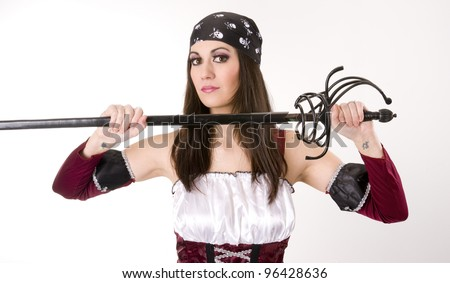 A beautiful pirate woman with her long sword hip weapon - stock photo