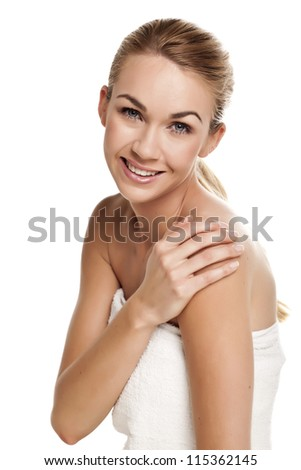 A beautiful portrait of a beautiful blond woman wearing a white towel.