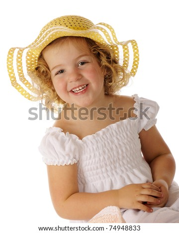 A beautiful preschooler in a white sundress and bright yellow hat.