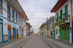 A beautiful red street with colonial architecture in the town of Filandia, Quindío, Colombia