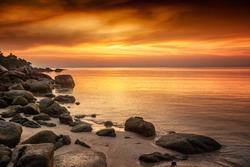 A beautiful rocky beach at sunset