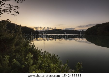 A beautiful sceenry of a lake surrounded by forests and mountains in Fal Estuary, Cornwall, UK Stock fotó ©