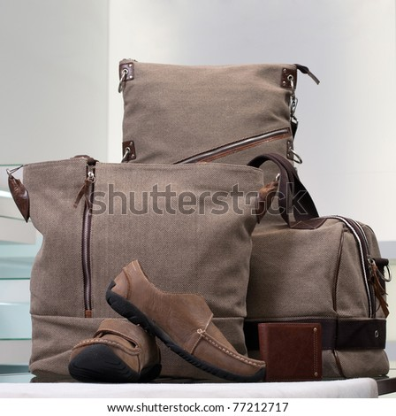 A beautiful set of canvas bags and leather man shoes