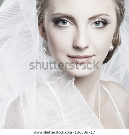 A beautiful sexual bride is in a wedding-dress, wedding decoration