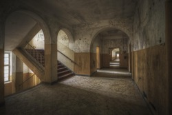 A beautiful shot of a hallway and stairs in an old building