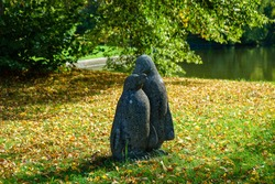 A beautiful shot of a penguin statue in the park