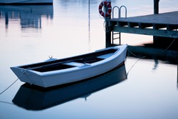 A beautiful shot of a rowboat tied in Saint Michaels, Maryland Harbor