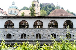 A beautiful shot of buildings with arch-shaped windows in Ljubljana, Slovenia