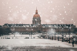 A beautiful shot of Les Invalides in Paris France under the snowy weather
